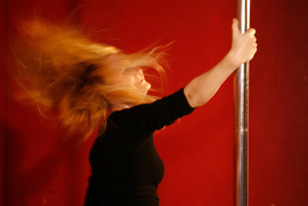 "Paris, France. October 15th 2007.A Pole Dance class at the ""Pole Dance Paris"" School.. .Pole Dance Paris.Studio 77 .77 Rue de Montreuil.75011 Paris."