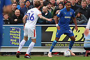 AFC Wimbledon midfielder Liam Trotter (14) taking on Luton Town defender Glen Rea (16) during the EFL Sky Bet League 1 match between AFC Wimbledon and Luton Town at the Cherry Red Records Stadium, Kingston, England on 27 October 2018.