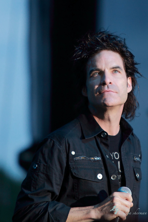 """INXS featuring Pat Monahan singing """"Beautiful Girl"""" performs during their """"Original Sin"""" tour at the Chateau Ste Michelle Winery in Seattle, Washington"""