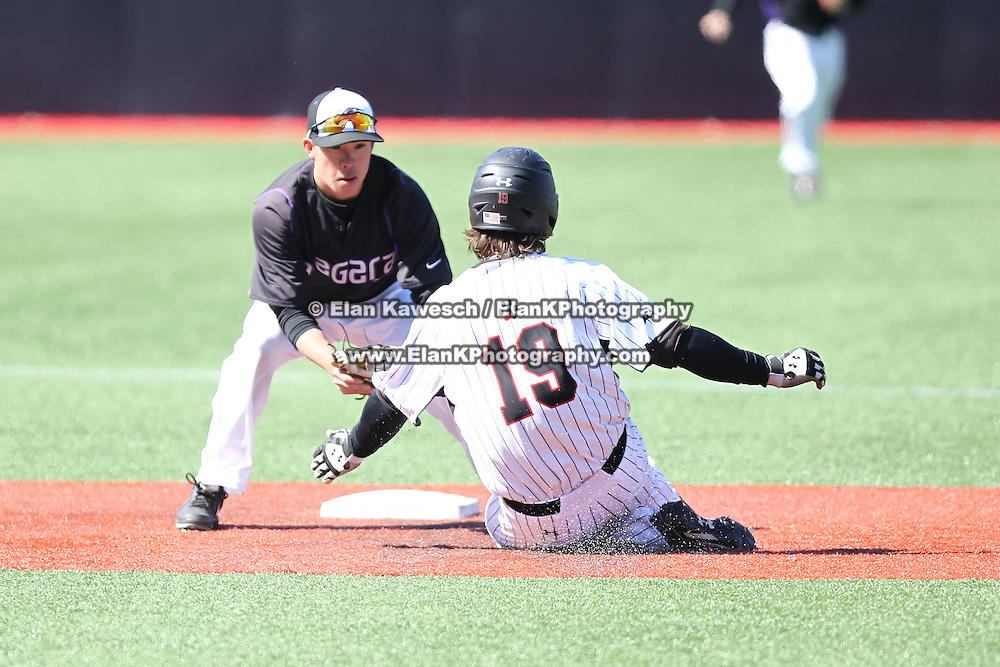 Geoff Seto #3 of the Niagara Purple Eagles puts a tag down on Mike Piscopo #19 of the Northeastern Huskies during the game at Friedman Diamond on March 16, 2014 in Brookline, Massachusetts. (Photo by Elan Kawesch)