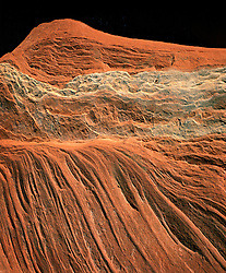 Abstract of red sandstone which appears to be an aerial photograph, but is actually 4 feet away