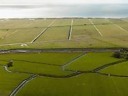 Nederland, Friesland, Gemeente Sudwest-Fryslan (Zuidwest-Friesland), 16-04-2012. Ten noorden van Workum, Polder de Beveiliging (voorgrond),   Polder Geele  Strand en grenzend aan het IJsselmeer het natuurreservaat de Workumerwaard..Polder near the IJssel lake (IJsselmeer) in Friesland..luchtfoto (toeslag), aerial photo (additional fee required);.copyright foto/photo Siebe Swart