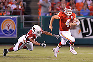 Quarterback Tyler Thigpen (4) of the Kansas City Chiefs rushes up field for a 20-yard gain past linebacker Clark Haggans (53) of the Arizona Cardinals in the second quarter at Arrowhead Stadium in Kansas City, Missouri on August 16, 2008.....