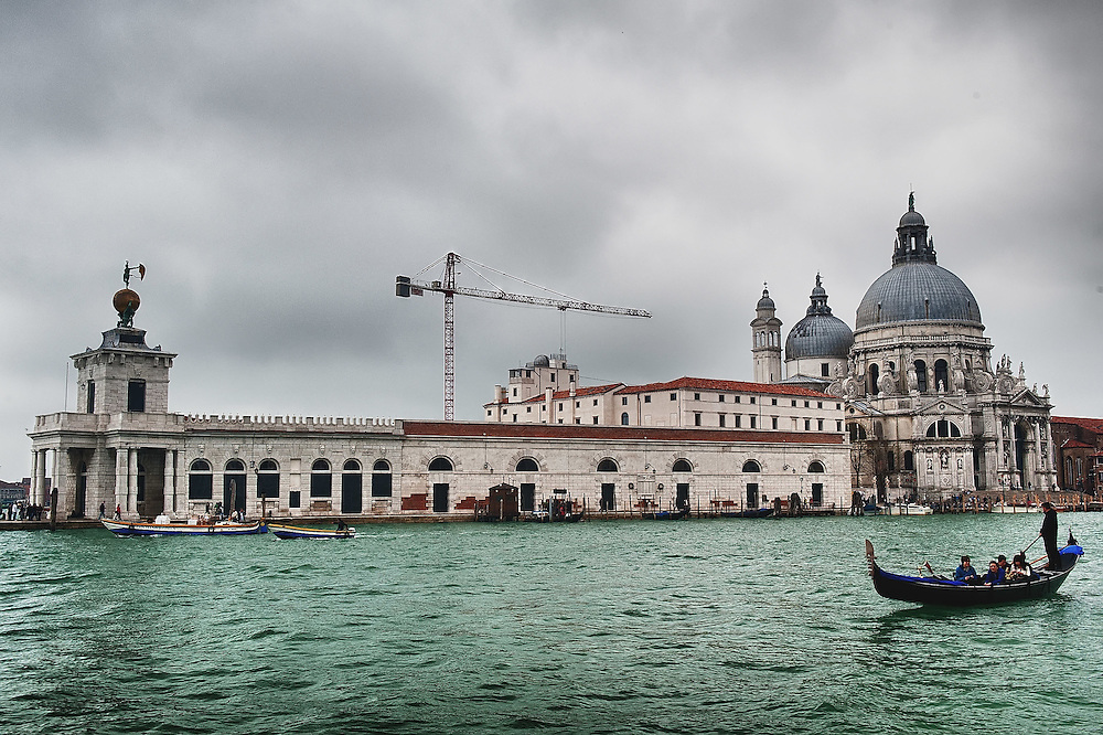 VENICE, ITALY - APRIL 04:  Ê A gondola sails in front  of Punta della Dogana leased to Mr Franois Pinault,  on the day of a protest against the sale and privatization of local buildings on April 4, 2012 in Venice, Italy. Several palaces and historical buildings in Venice have been recently sold by the Municipality or are currently for sale causing local anger.  (Photo by Marco Secchi/Getty Images)