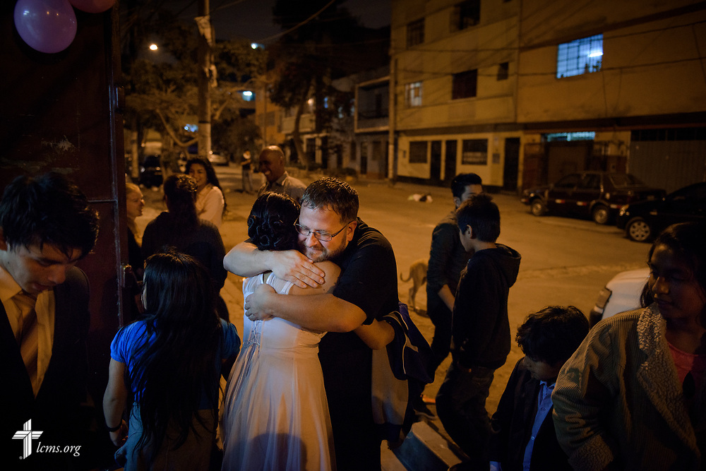 The Rev. Eddie Hosch, LCMS career missionary to Peru, receives hugs from new confirmands and friends following fellowship and worship at Castillo Fuerte on Saturday, Nov. 4, 2017, in the La Victoria district of Lima, Peru. LCMS Communications/Erik M. Lunsford