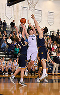 Petoskey Senior #3 Seth Mann defended by two Gaylord players as he drives to the basket.