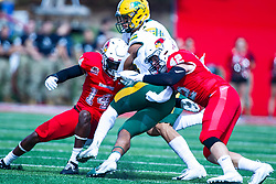 NORMAL, IL - October 05: Luther Kirk and Dylan Draka team up to stop the Bison ball carrier during a college football game between the ISU (Illinois State University) Redbirds and the North Dakota State Bison on October 05 2019 at Hancock Stadium in Normal, IL. (Photo by Alan Look)