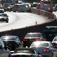 Traffic backs up on Highway 1 in Aptos, California on  July 31 as the three cars involved in a wreck in the southbound lanes are snarled along the center divide south of State Park Drive. No injuries were reported from the accident.<br />Photo by Shmuel Thaler/Santa Cruz Sentinel