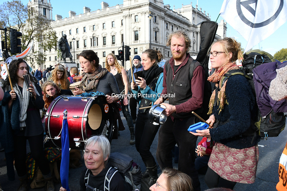 Declaration of Rebellion protest sit-in Against the British Government For Criminal Inaction in the Face of Climate Change Catastrophe and Ecological Collapse to have Zero carbon by 2025 in Parliament Square on 31 October 2018, London, UK.