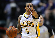 March 14, 2012; Indianapolis, IN, USA; Indiana Pacers shooting guard George Hill (3) motions to teammates against the Philadelphia 76ers at Bankers Life Fieldhouse. Indiana defeated Philadelphia 111-94. Mandatory credit: Michael Hickey-US PRESSWIRE