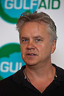 Tim Robbins, actor, activist criticizes BP and questions why they are the ones dictating who can use the airspace in the waters  close to the oil spill at a press conference at Gulf Aid a benefit concert for fishermen.