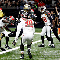 Dec 24, 2016; New Orleans, LA, USA; New Orleans Saints running back Travaris Cadet (38) scores a touchdown against the Tampa Bay Buccaneers during the second half of a game at the Mercedes-Benz Superdome. Mandatory Credit: Derick E. Hingle-USA TODAY Sports