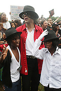 Michael Jackson impersonators at the Spike Lee's Brooklyn celebration for Michael Jackson's Birthday held at the Neader field in Prospect Park, Brooklyn on August 29, 2009..Filmmaker Spike Lee celebrates the ' King of Pop ' Birthday with a crowd packed party remembering the recently departing All time Great with a day long spinning of his music in Brooklyn's own Prospect Park