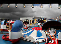 Jon M. Fletcher/The Times-Union-093007-- Threatening clouds roll in as Ham Jam-goers ride the Tilt-A-Whirl in Clay County during the annual event.  Afternoon showers sent many people home Sunday, September 30, 2007.  (The Florida Times-Union, Jon M. Fletcher)