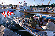 "Wooden Boat Festival 2016: Folks chat aboard the 39 foot classic 1926 racing sloop ""Pirate"" designed by the famed Ted Geary. Owned now by the Center for Wooden Boats of Seattle."
