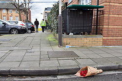 © Licensed to London News Pictures. 20/02/2018. LONDON, UK. A floral tribute lies outside the police cordon. Police officers and a forensics team attend the scene in Halliday Square, Southall, West London, where a 26 year old man was fatally stabbed on the afternoon of 19 February.  A 39 year old man was arrested at the scene and is in custody.  Investigations are ongoing.  Photo credit: Stephen Chung/LNP