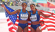 Raeven Rogers (left) and Ajee Wilson (USA) pose after placing second and third in the women's 800m during the IAAF World Athletics Championships, Monday, Sept. 30, 2010, in Doha, Qatar. (Claus Andersen/Image of Sport)