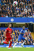 Liverpool forward Mohamed Salah (11) and Chelsea midfielder Ngolo Kanté (7) during the Premier League match between Chelsea and Liverpool at Stamford Bridge, London, England on 22 September 2019.
