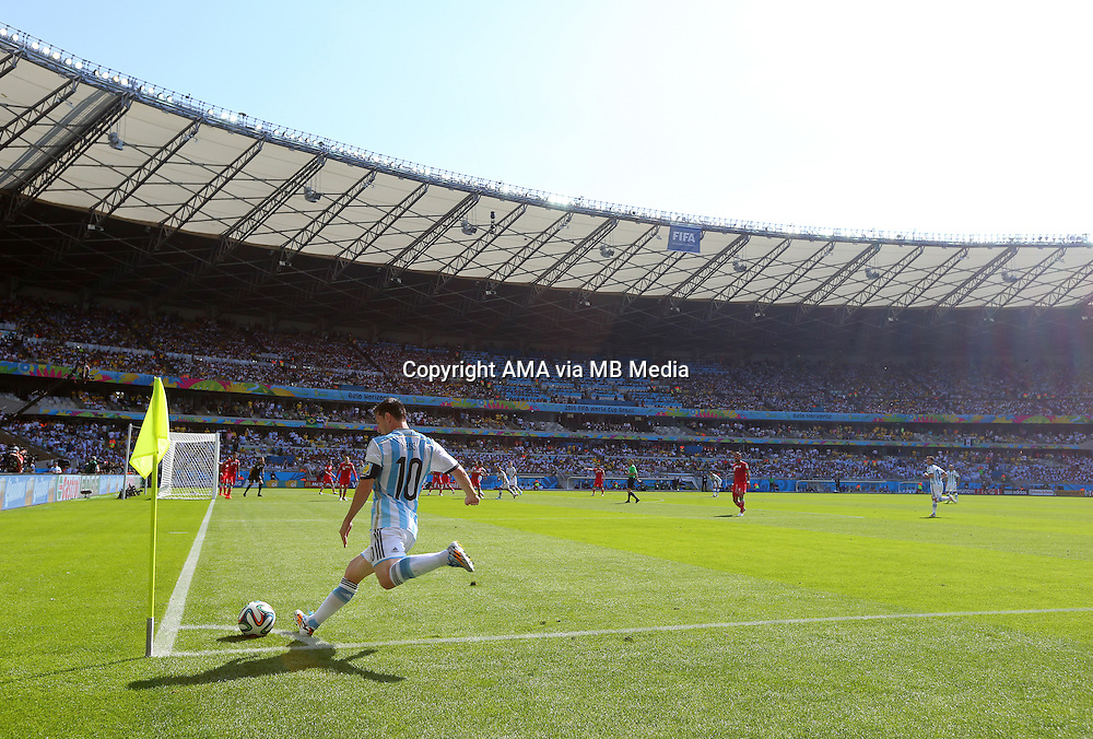 Lionel Messi of Argentina takes a corner kick at The Belo Horizonte FIFA World Cup Stadium in Brazil, also known as Estadio Governador Magalhaes Pinto, Mineirao / Toca da Raposa III. It is the largest football stadium in the state of Minas Gerais, Brazil and home to Cruzeiro