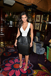 KIM KARDASHIAN WEST at a dinner to celebrate the launch of Genetic - Liberty Ross hosted by Liberty Ross and Ali Fatourechi at Annabel's, 44 Berkeley Square, London on 3rd September 2014.