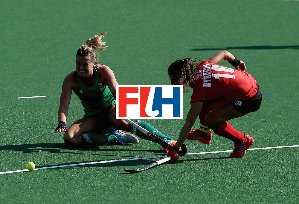 JOHANNESBURG, SOUTH AFRICA - JULY 12: Nicola Evans of Ireland and Marlena Rybacha of Poland battle for possession  during day 3 of the FIH Hockey World League Semi Finals Pool A match between Ireland and Poland at Wits University on July 12, 2017 in Johannesburg, South Africa. (Photo by Jan Kruger/Getty Images for FIH)