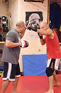 Randy Couture (left) and Gil Martinez do some focus mitt work during a training session ahead of UFC 105 at Straight Blast Gym in Manchester, England on November 11, 2009.