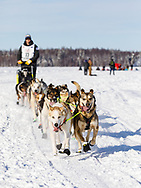 Musher  Joar Leifseth Ulsom after the restart in Willow of the 46th Iditarod Trail Sled Dog Race in Southcentral Alaska.  Afternoon. Winter.