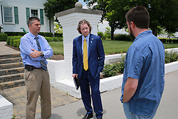 David Stephenson and D'Art Lykins have a impromptu meeting with Mark Lyons heir of Alltech about the benefits of Pigeon Supplements which Stephenson was at the beginning of developing for commercial sale, Thursday, June 12, 2014 at Connemera Golf Club in Lexington.