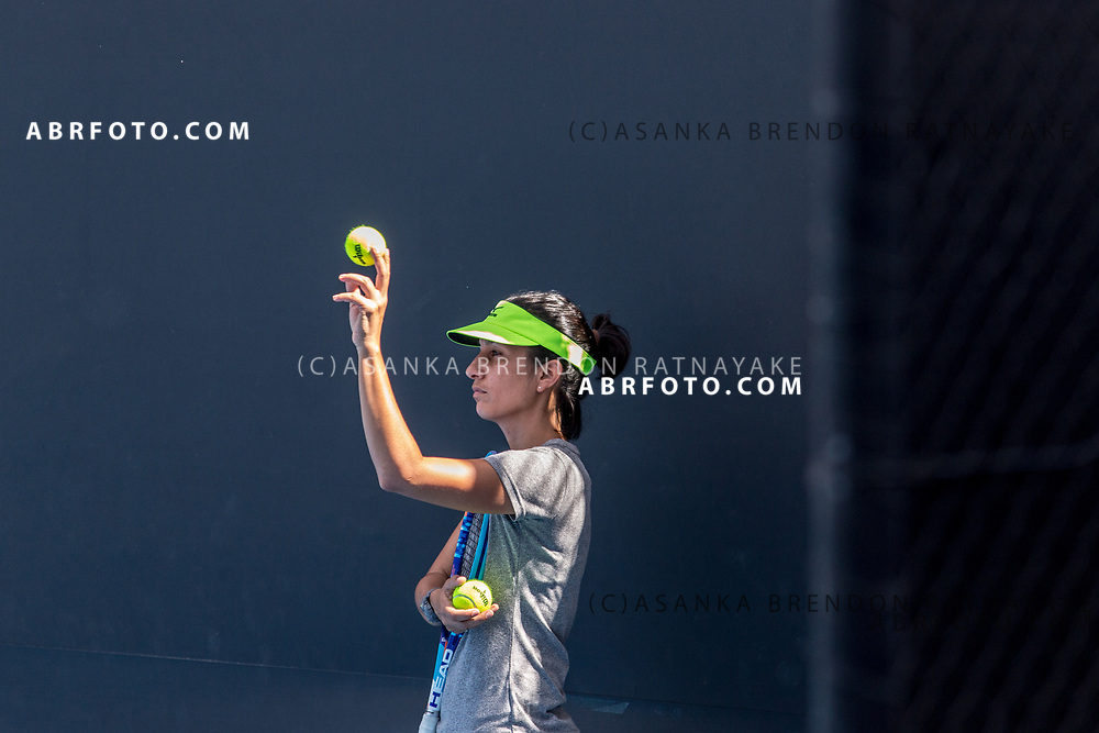 Coach Elise Tamaëla releases a tennis ball from her hand during a training session at Melbourne Park in Melbourne, Australia on the 11th of January 2018. Asanka Brendon Ratnayake for The New York Times