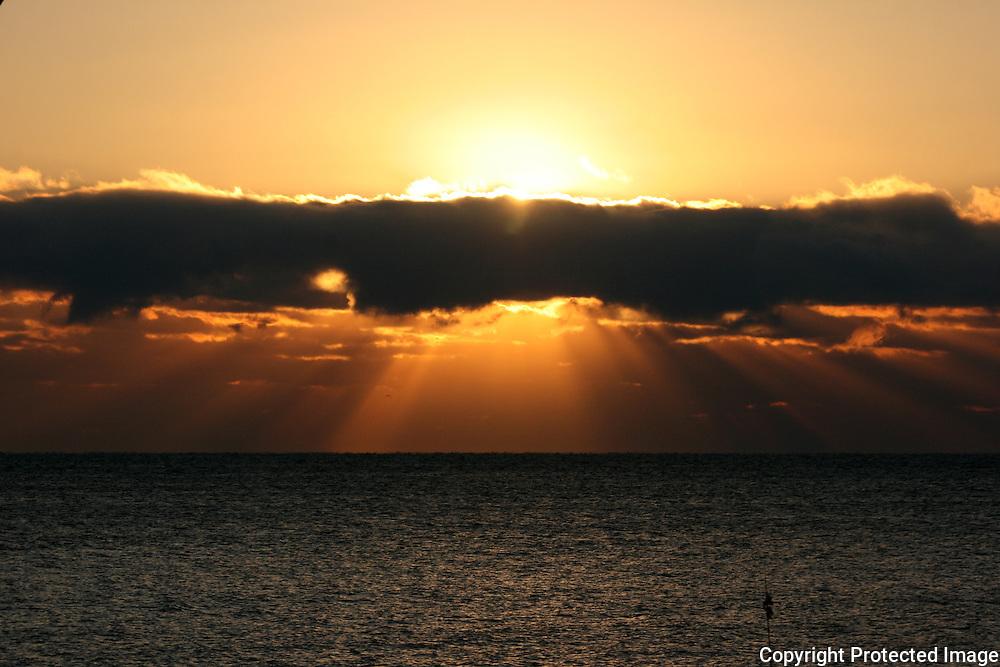 A fiery Atlantic sunrise on a Jekyll Island Georgia beach.