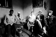 Cairo, Egypt, The City of the Dead, 2000 - Tea and shesha  is shared by the laborers and undertakers in Abdul Rassy's area near the Qaitbay Mosque.
