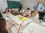 Project advisor team members for Garden Oaks Montessori K-8 confer about design options during a design charrette, April 29, 2015.