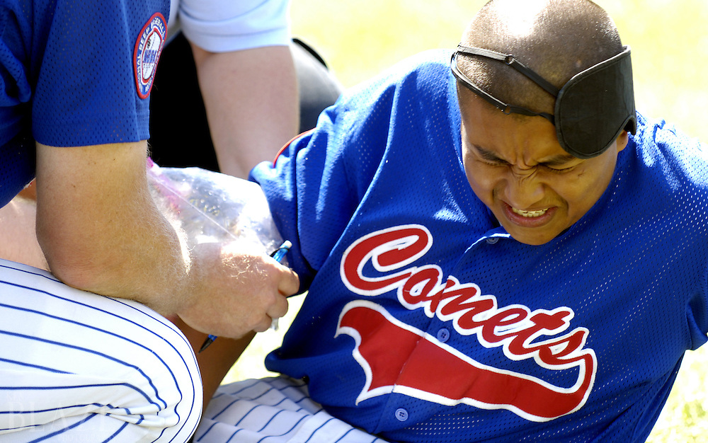 Bernando Barrera of the Chicago Comets is treated for an arm injury during a game against the Cleveland Scrappers at the 2006 World Series of Beep Baseball in Strongsville, Ohio..Photo by Ken Blaze