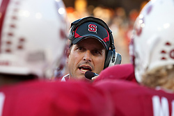 September 26, 2009; Stanford, CA, USA; Stanford Cardinal head coach Jim Harbaugh talks to his team during a time out against the Washington Huskies during the first quarter at Stanford Stadium. Stanford defeated Washington 34-14. Mandatory Credit: Jason O. Watson-US PRESSWIRE