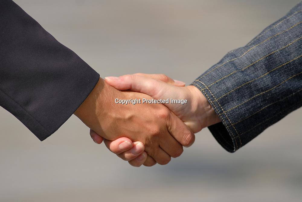 handshake between businessmans