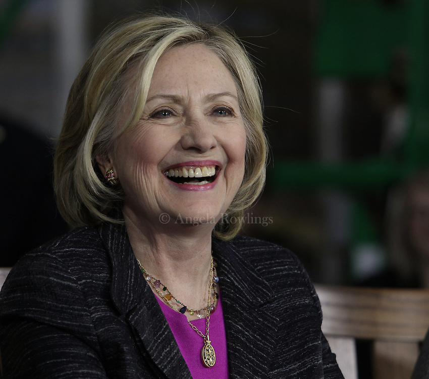 (Hampton, NH - 5/22/15) Former Secretary of State and presidential candidate Hillary Clinton laughs during a roundtable discussion with small business owners at Smuttynose Brewery, Friday, May 22, 2015. Staff photo by Angela Rowlings.