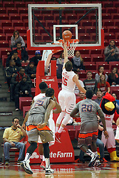 17 December 2014:  Justin McCloud finishes off a steal and break away with a layup at the far end of the court during an NCAA Men's Basketball game between the Skyhawks of University of Tennessee - Martin and the Redbirds of Illinois State at Redbird Arena in Normal Illinois