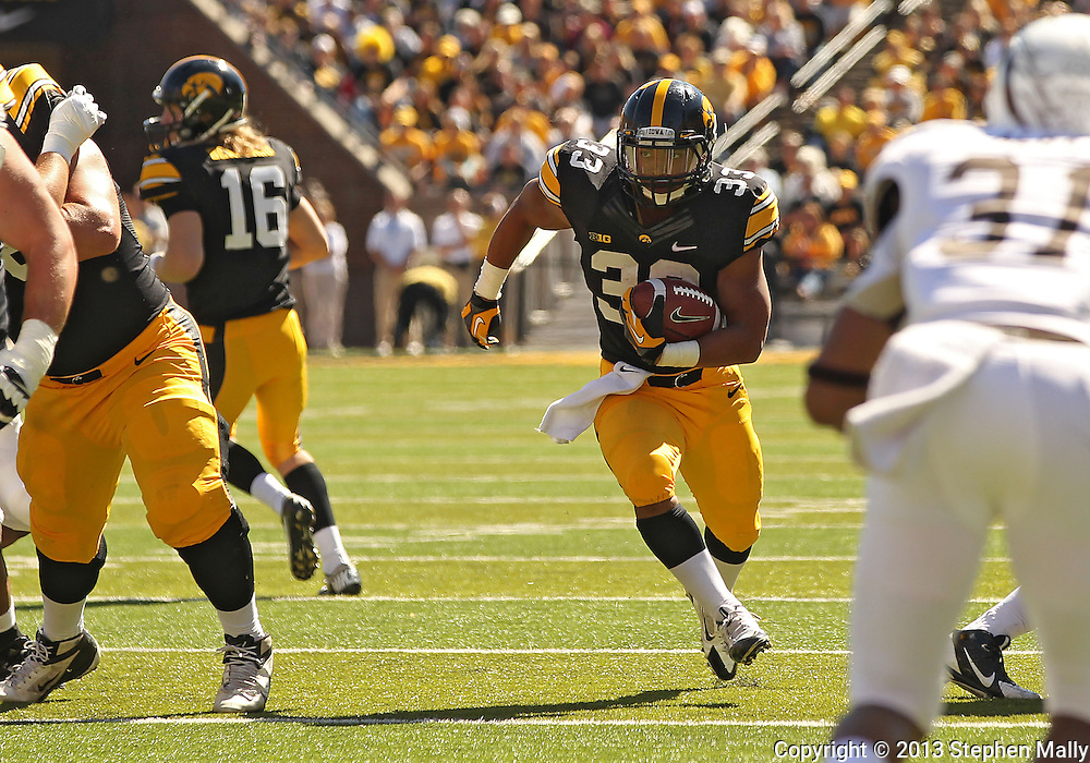 September 21 2013: Iowa Hawkeyes running back Jordan Canzeri (33) carries the ball during the fourth quarter of the NCAA football game between the Western Michigan Broncos and the Iowa Hawkeyes at Kinnick Stadium in Iowa City, Iowa on September 21, 2013. Iowa defeated Western Michigan 59-3.