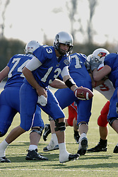 25 November 2006: Cole Stinson reaches back to hand off.&#xD;The Redbirds romped the Panthers by a score of 24-13.&#xD;This game was a 1st round NCAA Division 1 Playoff held at O'Brien Stadium on the campus of Eastern Illinois University in Charleston Illinois.<br />