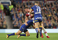 Joe Greenwood of Wigan Warriors attempts to break through the tackles of Tyrone Roberts and Toby King of the Warrington Wolves during the Betfred Super League Grand Final at Old Trafford, Manchester.<br /> Picture by Michael Sedgwick/Focus Images Ltd +44 7900 363072<br /> 13/10/2018