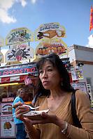 Woman Eating a Deep Fried Twinkie, L.A. County Fair, California