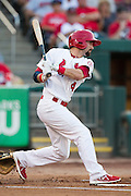 Adam Melker (4) of the Springfield Cardinals follows through his swing after making contact on a pitch during a game against the Northwest Arkansas Naturals at Hammons Field on August 23, 2013 in Springfield, Missouri. (David Welker)
