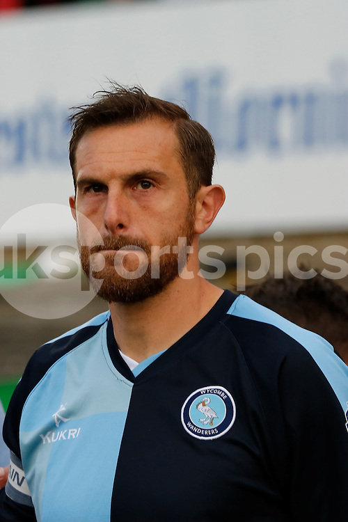 Wycombe Wanderers captain Paul Hayes leads his side onto the pitch for the Sky Bet League 2 Play Off 1st Leg match between Plymouth Argyle and Wycombe Wanderers at Home Park, Plymouth, England on 9 May 2015. Photo by Mark Hawkins.