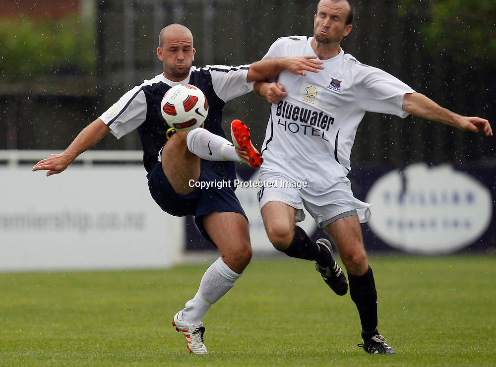 Auckland's Stuart Kelly tangles with Bays Chris McIvor. ASB Premiership, Auckland City FC v Hawkes Bay United, Kiwitea Street Auckland, Saturday 18th December 2010. Photo: Shane Wenzlick