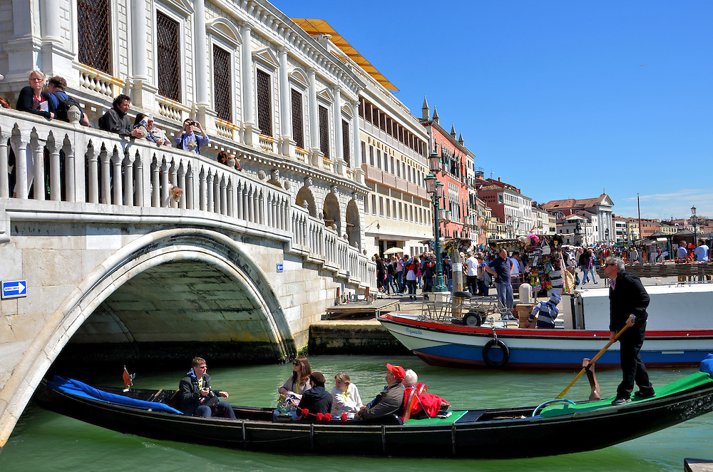 Gondola Under Ponte della Paglia in Venice, Italy<br />