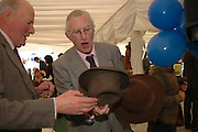 Col. David Lewis and Michael Griffiths. Ludlow Charity Race Day,  in aid of Action Medical Research. Ludlow racecourse. 24 march 2005. ONE TIME USE ONLY - DO NOT ARCHIVE  © Copyright Photograph by Dafydd Jones 66 Stockwell Park Rd. London SW9 0DA Tel 020 7733 0108 www.dafjones.com