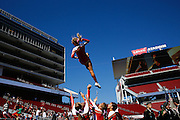 An Oakdale cheerleader is thrown in the air before the game against Manteca during Friday Night Lights at Levi's Stadium in Santa Clara, California, on October 11, 2014. (Stan Olszewski/ Special to The Record)