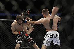 Dec 12, 2009; Memphis, TN, USA; Welterweights Jon Fitch and Mike Pierce during their bout at UFC 107 at the FedEx Forum in Memphis, TN.