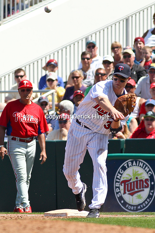 March 13, 2011; Fort Myers, FL, USA; Minnesota Twins first baseman Justin Morneau (33) throws to third base during a spring training exhibition game against the Minnesota Twins at Hammond Stadium.   Mandatory Credit: Derick E. Hingle