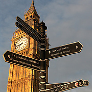 Big Ben, north tower of British Houses of Parliament, London, England, UK, with direction signs in foreground<br />